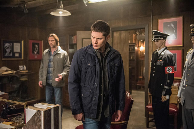 Dean diligently searches the room - Supernatural Season 12 Episode 5