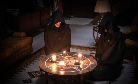 Putting candles on the table - Supernatural Season 12 Episode 7