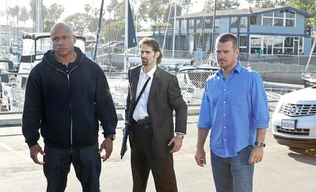 Sam, Callen and an Armed Man