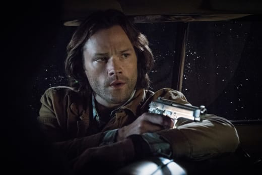 Sam aims his gun - Supernatural Season 12 Episode 21