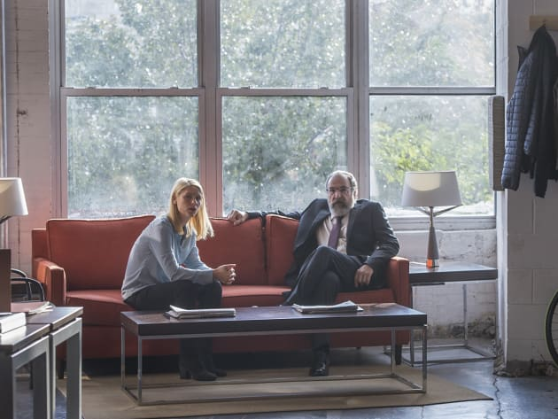 Carrie and Saul Chat in her Office