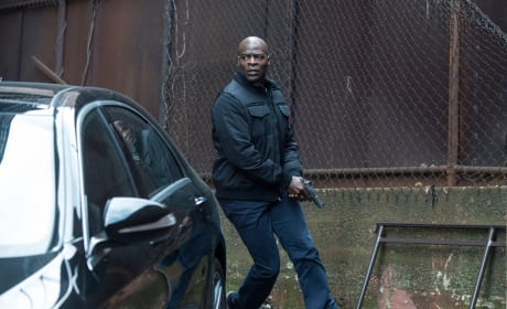 Dembe races to the car - The Blacklist Season 4 Episode 21
