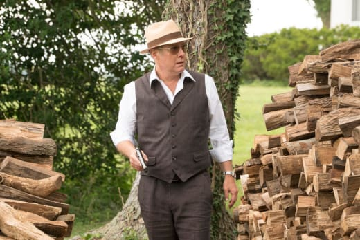 Red searches behind the log pile - The Blacklist Season 4 Episode 1