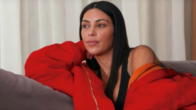 Kim in red keeping up with the kardashians
