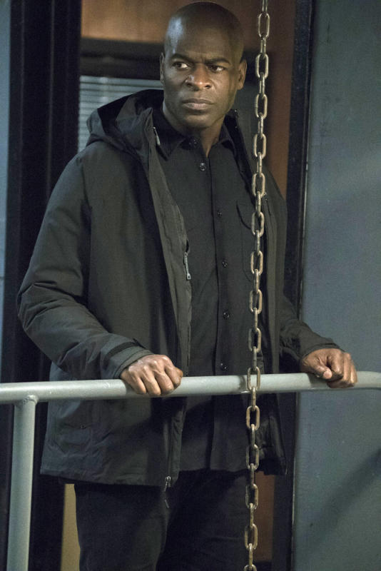 Dembe pauses to check out the area - The Blacklist Season 4 Episode 14