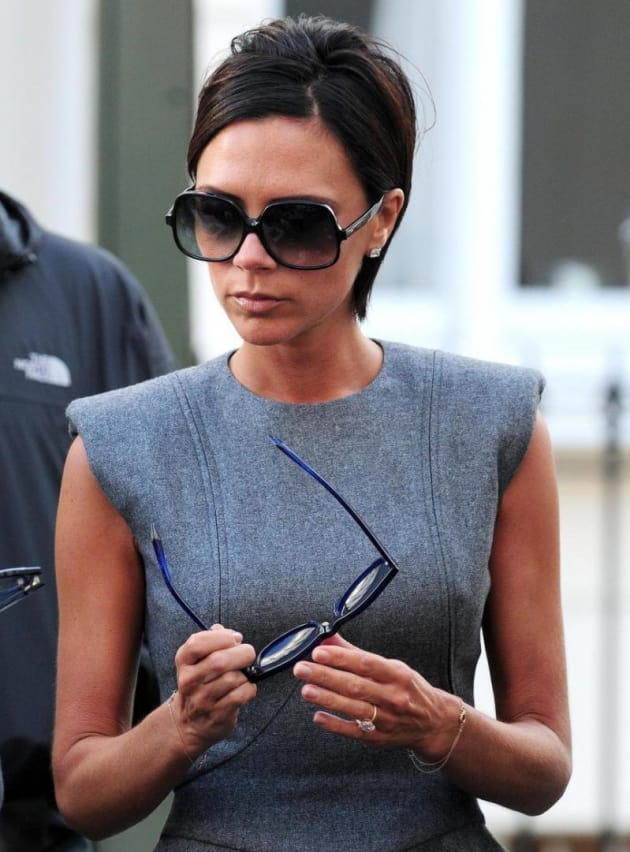 Victoria beckham oozes glamour as she poses in one of her own designs