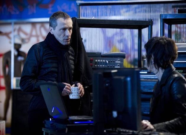 Michael Wincott as Adrian Cross