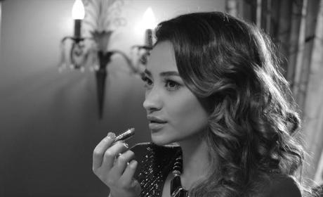 Emily Putting on Lipstick