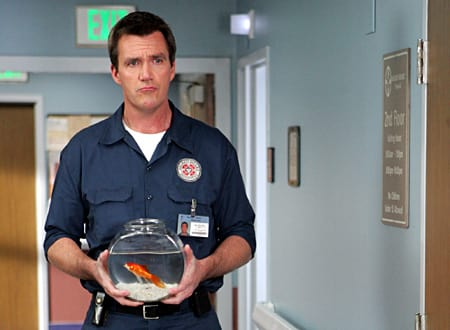 Janitor Holds a Goldfish