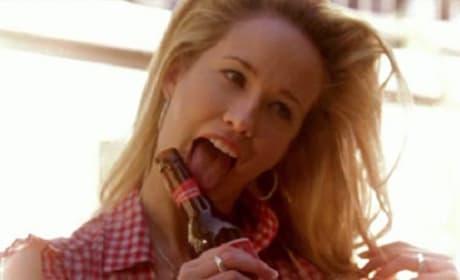 Sarah Newlin Licks a Beer Bottle