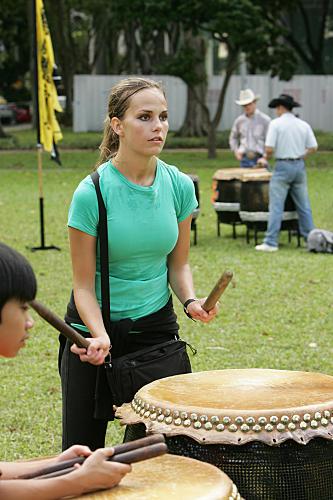 Caite Bangs the Drum