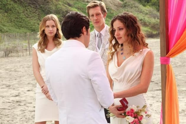 Emily Looks on at Wedding