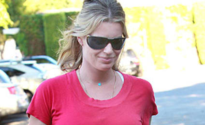 Rebecca Romijn Shows Off Baby Bump