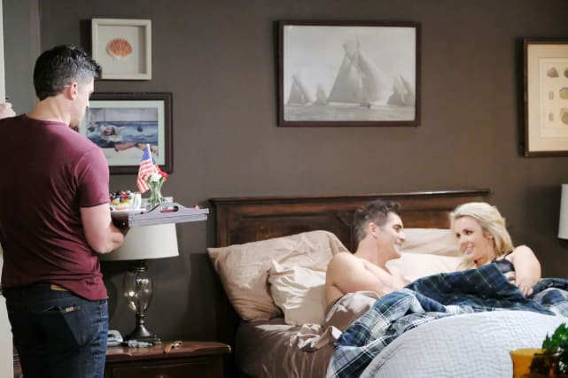 Eric discovers Rafe and Carrie in bed.
