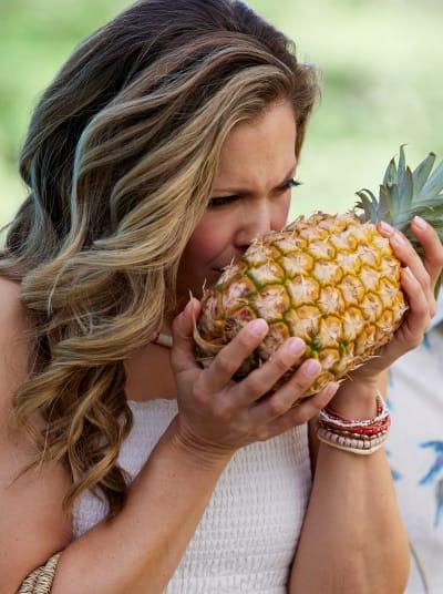 Paige Sniffs a Pineapple
