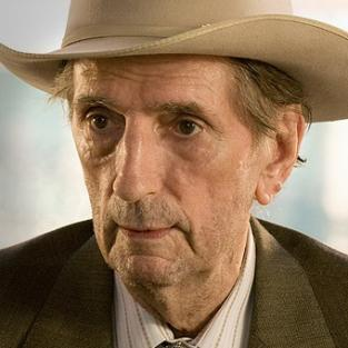 Harry Dean Stanton as Roman Grant