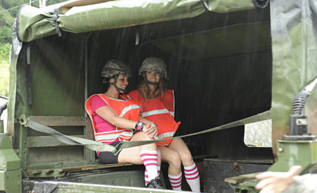Claire and Brook Sit in a Humvee