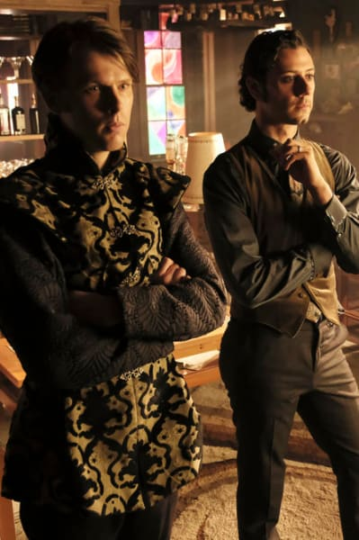 Eliot and Charlton Look Seriously at a Chalkboard - The Magicians Season 4 Episode 5
