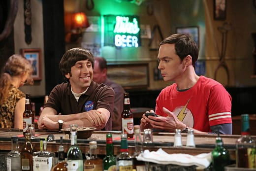 Howard Smiles at the Bar with Sheldon