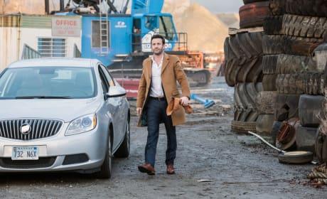 Mick strolls through a junkyard - Supernatural Season 12 Episode 17