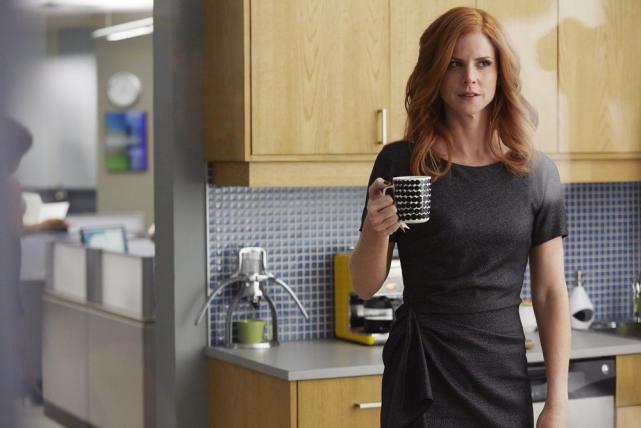 Donna Raises a Mug