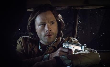 Sam aims his gun - Supernatural Season 12 Episode 21