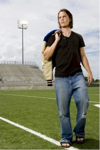 Taylor Kitsch as Tim Riggins